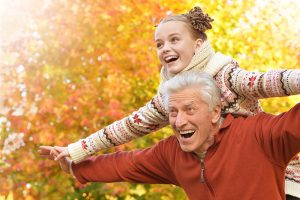 grandparent and child having fun outdoors